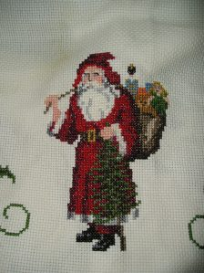 Santa with bag of toys on back