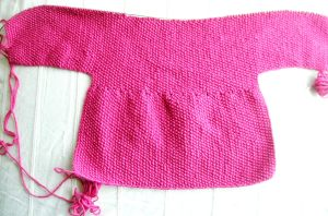 "Debbie Bliss ""Baby Cardigan"" Back, Photographed Straight-on"