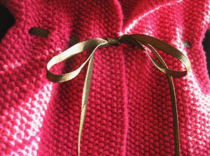 """Baby Cardigan,"" Close up with Chocolate Grosgrain Ribbon"