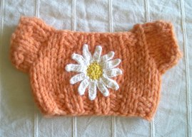 Orange Sweater with Crocheted Daisy